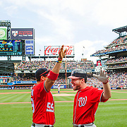 NEW YORK, NEW YORK - July 10: Daniel Murphy #20 of the Washington Nationals is congratulated by Jose Lobaton #59 of the Washington Nationals on his return to the dugout after hitting a two run home run in the first inning during the Washington Nationals Vs New York Mets regular season MLB game at Citi Field on July 10, 2016 in New York City. (Photo by Tim Clayton/Corbis via Getty Images)