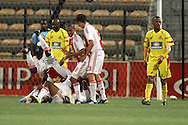 CAPE TOWN, SOUTH AFRICA - 11 FEBRUARY 2011, Ajax Cape Town celebrate their third goal during the Absa Premiership match between Santos and Ajax Cape Town held at Athlone Stadium in Cape Town, South Africa..Photo by: Shaun Roy/Sportzpics