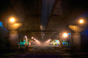 Scary Railway Stations at night. About 9:30. Two figures on the platform at Macaulay railway station under heavey fog. The station is built under the CityLink Tollway. Pic By Craig Sillitoe CSZ/The Sunday Age/The Age iPad App.28/06/2011 This photograph can be used for non commercial uses with attribution. Credit: Craig Sillitoe Photography / http://www.csillitoe.com<br />