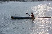 Man Paddling a Kayak in the Ocean