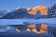 The Canadian Rocky Mountains reflected in Lake Louise at sunrise, Banff National Park, Alberta, Canada