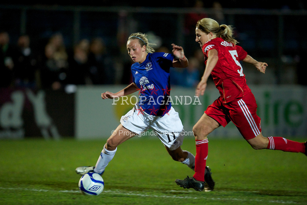 SKELMERSDALE, ENGLAND - Thursday, April 14, 2011: Everton's Toni Duggan in action against Liverpool's Nicky Twohig during the opening FA Women's Super League match at Stoney Corner. (Photo by David Rawcliffe/Propaganda)