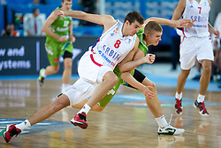 Nemanja Bjelica #8 of Serbia and Edo Muric #8 of Slovenia in battle for ball during basketball match between national team of Serbia and Slovenia at Eurobasket 2013 on September 19, 2013 in SRC Stozice, Ljubljana, Slovenia. (Photo By Matic Klansek Velej / Sportida.com)