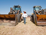 31 JULY 2009 --  BUCKEYE, AZ: Keith Boyle (CQ) from Casa Grande, checks out the equipment at the auction on the former Pylman Dairy Farm in Buckeye. The auction was handled by Overland Stockyards from Hanford, CA. The Arizona dairy industry is struggling to survive the worst milk economy some have ever seen. Due to the global recession, overseas demand for Arizona dairy products has plummeted, forcing prices down while production costs have stayed stable or gone up. For every $1 dairymen earn from milk sales, it cost them $1.50 to produce the milk. Photo by Jack Kurtz