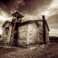 A timber shack with dramatic sky