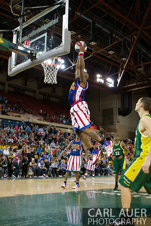 April 30th, 2010 - Anchorage, Alaska: Harlem Globetrotter Moo Moo Evans extends for a thundering dunk Friday night.