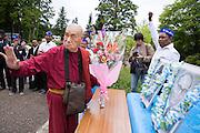 Japan-born monk Surai Sasai leads a prayer ceremony at the headquarters of the Shingon Buddhist sect on Mount Koya, Wakayama Prefecture, on June 14 2015. The portraits depict Buddha and Dalit social reformer Bhimrao Ramji Ambedkar.<br />  <br /> Photo by Christina Sj&ouml;gren