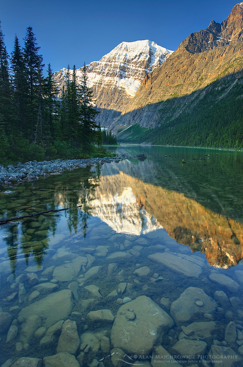 Mount Edith Cavell 3,363 m (11,033 ft) viewed from Cavell Lake, Jasper National Park Alberta Canada