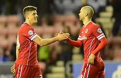 Cardiff City's Alex Revell (L) celebrates at the final whistle with team-mate  Sean Morrison - Photo mandatory by-line: Richard Martin-Roberts/JMP - Mobile: 07966 386802 - 24/02/2015 - SPORT - Football - Wigan - DW Stadium - Wigan Athletic v Cardiff City - Sky Bet Championship