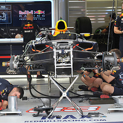 Max Verstappen's Infiniti Red Bull Racing car being prepared.<br /> Day 1 of the 2017 Formula 1 Singapore airlines, Singapore Grand Prix, held at The Marina Bay street circuit, Singapore on the 14th September 2017.<br /> Wayne Neal | SportPix.org.uk