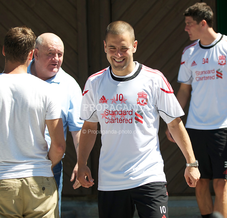 BAD RAGAZ, SWITZERLAND - Tuesday, July 20th, 2010: Liverpool's new signing Joe Cole shares a joke with his father after his first training session with the Reds during a preseason training camp in Switzerland. (Pic by David Rawcliffe/Propaganda)