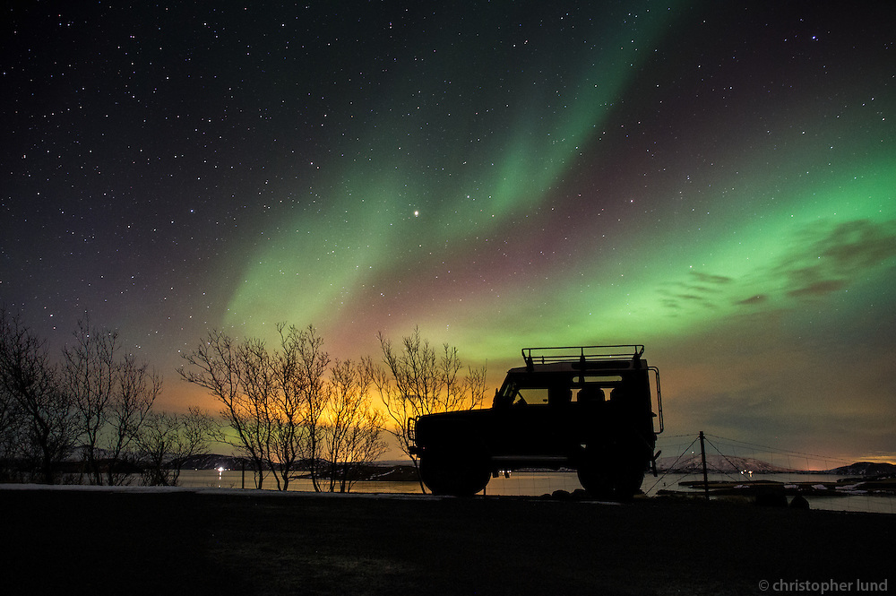 My trusty old Land Rover Defender 90 silhouetted by Northern Lights over Lake Þingvallavatn, South Iceland.