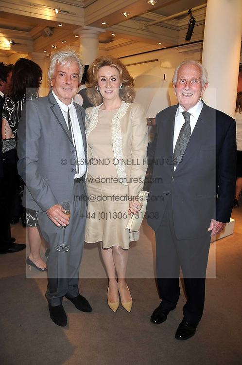Left to right, NICKY HASLAM and LORD &amp; LADY WOLFSON at the annual Sotheby's Summer Party held at their auction rooms 34-35 New Bond Street, London W1 on 19th June 2008.<br />