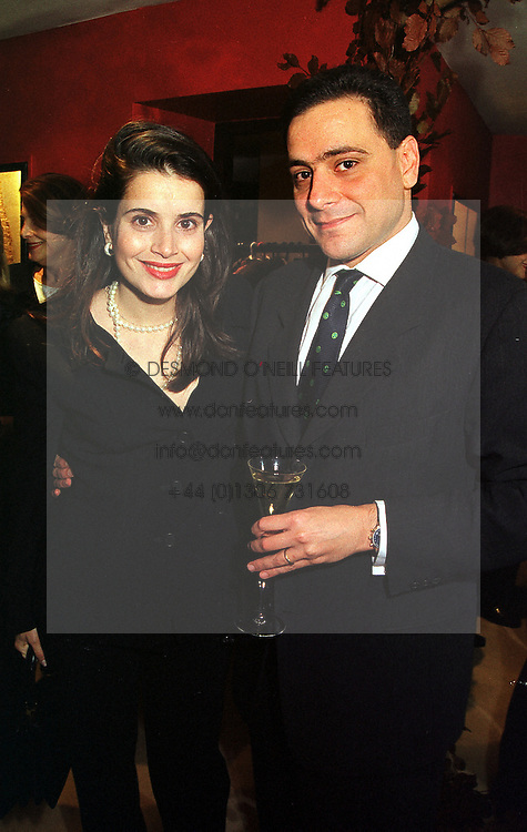 MR & MRS MOUNZER NASR she is the daughter of Senhora Flecha de Lima a friend of the late Diana, Princess of Wales, at a party in London on 30th November 1999.MZP 51