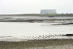 © Licensed to London News Pictures. 21/10/2013.  Hinkley Point, Somerset, UK.  Hinkley Point Nuclear Power Station, which currently comprises the decommissioned Hinkley A station with Magnox Reactors (blue square buildings) and Hinkley B station (grey building complex, a more modern AGR design). The UK Government today announced the go-ahead for a new nuclear power station at Hinkley Point C in Somerset, to be built by a consortium with French firm EDF Energy and Chinese investment for the first time in UK nuclear power generation.21October 2013.<br /> Photo credit : Simon Chapman/LNP