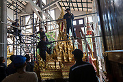 Scaffolding is removed from one of the intricate royal chariots that will be used during the Royal Cremation Ceremony.<br /> <br /> The area around the Royal Palace in Bangkok is busy in preparation for the ceremony that will take place between 25-29 October 2017. It will be the final tribute and farewell to the revered His Majesty King Bhumibol Adulyadej (Rama IX) who died on the 13 October 2016 aged 89.