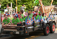 Opechee Day Campers ride the waves as they make thier way down North Main Street during the annual July 4th parade Thursday afternoon.  (Karen Bobotas/for the Laconia Daily Sun)