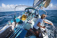 Patagonia ambassador Liz Clark trimming her sails. French Polynesia