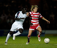 Photo: Jed Wee/Sportsbeat Images.<br /> Doncaster Rovers v Bolton Wanderers. The FA Cup. 06/01/2007.<br /> <br /> Doncaster's James Coppinger (R) tries to get away from Bolton's Johann Smith.