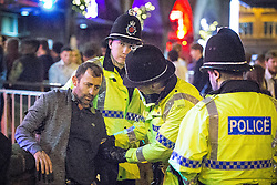 "© Licensed to London News Pictures . 19/12/2015 . Manchester , UK . Police detain a man at Deansgate Locks . Revellers in Manchester enjoy "" Mad Friday "" - also known as "" Black Eye Friday "" - the day on which emergency services in Britain are typically at their busiest , as people head out for parties and drinks to celebrate Christmas . Photo credit : Joel Goodman/LNP"
