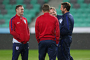 England Manager Gareth Southgate (caretaker) shares  joke with England Midfielder Wayne Rooney during a general stadium walk around before the Slovenia vs England FIFA World Cup Group F Qualifier match at Stadion Stozce, Ljubljana, Slovenia on 10 October 2016. Photo by Phil Duncan.