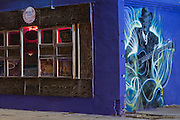 Delta Blues Alley Cafe for soul food with mural of guitarist musician in Clarksdale, birthplace of the Blues, Mississippi, USA