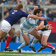 Gonzalo Tiesi, Argentina, is tackled by Dimitri Szarzewski, France, during the Argentina V France test match at Estadio Jose Amalfitani, Buenos Aires,  Argentina. 26th June 2010. Photo Tim Clayton...