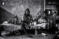Esther Yumbi having breakfast in her home in Kennedy Hill. Due to excessive alcohol consumption she has been diagnosed with diabetes and is now being treated with dialysis  in Perth Hospital 2300 km away. <br /> <br /> Many members of Aboriginal communities are traumatised by events from the past and for not being recognised. And for that, self-medication in the form of alcohol, cannabis, gambling, violence and amphetamines leads to health problems, unemployment, sexual and physical violence, foetal alcohol spectrum disorder, etc. until the circle breaks, as in people committing suicide, ending up in jail or just surviving till the end.<br /> <br /> Broome, Western Australia. <br /> &copy;Ingetje Tadros/Diimex
