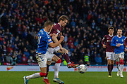 Craig Wighton of Hearts plays the ball around Borna Barisic of Rangers FC during the Betfred Scottish League Cup semi-final match between Rangers and Heart of Midlothian at Hampden Park, Glasgow, United Kingdom on 3 November 2019.