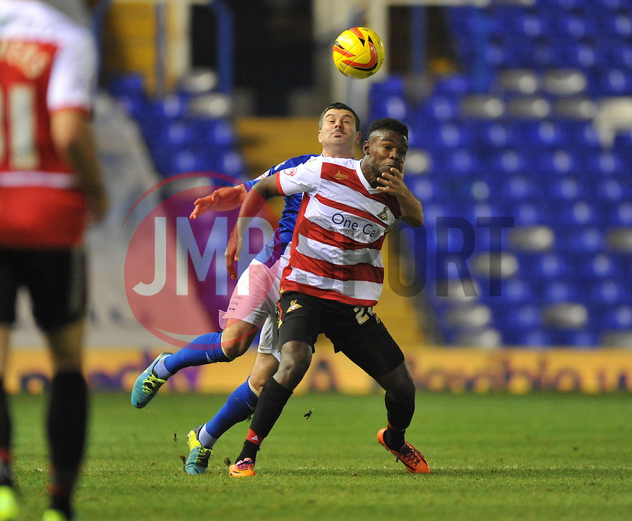 Birmingham City's Paul Robinson holds Doncaster Rovers'  around the face while trying to head the ball. - Photo mandatory by-line: Alex James/JMP - Tel: Mobile: 07966 386802 03/12/2013 - SPORT - Football - Birmingham - St Andrews - Birmingham City v Doncaster Rovers - Sky Bet Championship