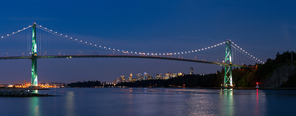 The Lions Gate Bridge with downtown Vancouver underneath from Ambleside Beach in West Vancouver, British Columbia, Canada