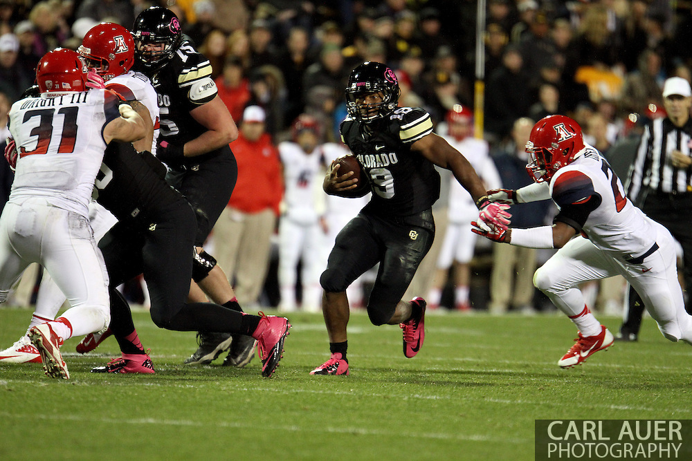 October 26th, 2013:  Colorado Buffaloes freshman running back Michael Adkins II (19) looks for a hole in the Arizona defense during the third quarter of the NCAA football game between the University of Arizona Wildcats and the University of Colorado Buffaloes at Folsom Field in Boulder, Colorado