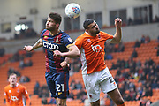 Bradford City striker Kai Brunker (21) and Blackpool midfielder Colin Daniel (23) during the EFL Sky Bet League 1 match between Blackpool and Bradford City at Bloomfield Road, Blackpool, England on 7 April 2018. Picture by Craig Galloway.