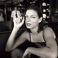 Woman smoking a cigarette in restaurant, South Beach, Miami, Florida