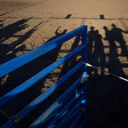 Long Shadows late in the day as the Open Bull Riding competition takes place at the Branxton Rodeo at Branxton, Hunter Valley,  New South Wales, Australia, on Saturday 17th October 2009.  Photo Tim Clayton.