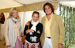 Left to right, ROSE BETHILL, HANNELI RUPERT and JANAN VON NOBODIBURG at the 2005 Cartier International Polo between England & Australia held at Guards Polo Club, Smith's Lawn, Windsor Great Park, Berkshire on 24th July 2005.<br />