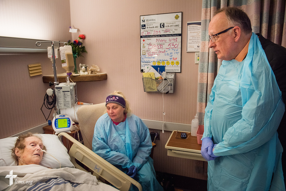 The Rev. Doug Nicely, chaplain at Memorial Hospital in Belleville, Ill., visits and prays with patient Arline Klitzine and Bea Dull on Monday, Jan. 12, 2015. LCMS Communications/Erik M. Lunsford