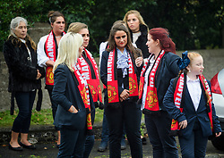 © Licensed to London News Pictures. 26/10/2017. Epsom, UK. A group of young women wearing Manchester United shirts attend the funeral of Tom 'Tomboy' Doherty the nephew of Big Fat Gypsy Weddings star Paddy Doherty, at Epsom Cemetery in Epsom, Surrey. Tom Doherty was 17 when he was killed in a car crash in South Nutfield in Surrey on October 9. He had passed his driving test just days earlier. Photo credit: Ben Cawthra/LNP