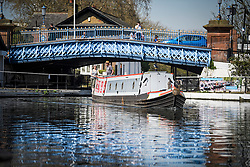 © Licensed to London News Pictures. 19/04/2018. London, UK. A canal boat makes it way through Little Venice in West London as parts of the UK are enjoying high unseasonal April temperatures. Photo credit: Ben Cawthra/LNP