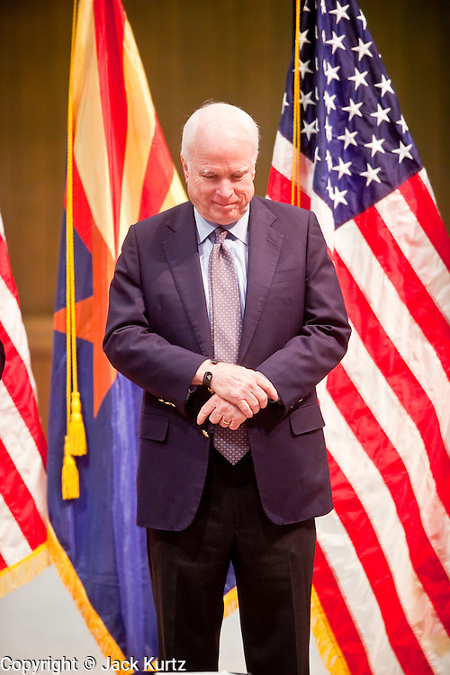 Nov. 23, 2009 -- PHOENIX, AZ: Sen. JOHN McCAIN (R-AZ) bows his head in prayer during a town hall meeting on health care reform at North Phoenix Baptist Church in Phoenix, AZ. About 300 people, most of them medical professionals, attended the meeting to hear Sen. McCain talk about the health care reform proposals currently in congress and to give McCain their opinions on health care reform.   Photo by Jack Kurtz