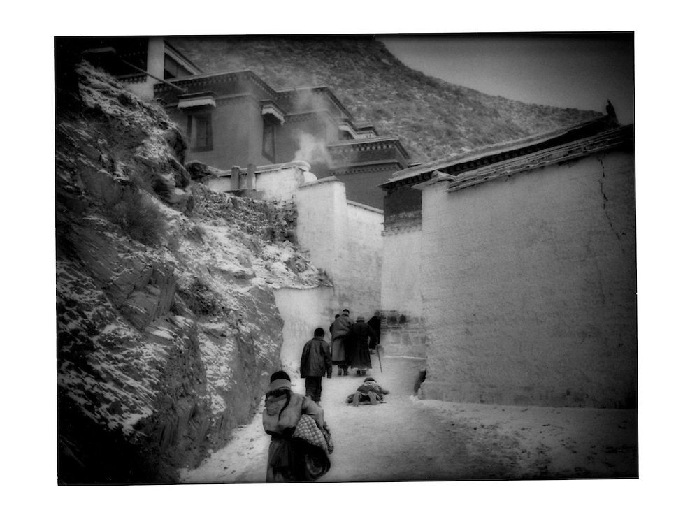 Tibetan herdswomen pilgrim prostrates the entire distance circumambulating Labrang(Tibetan Buddhist) Monastery, Amdo, Tibet (Xiahe, Gansu, China).