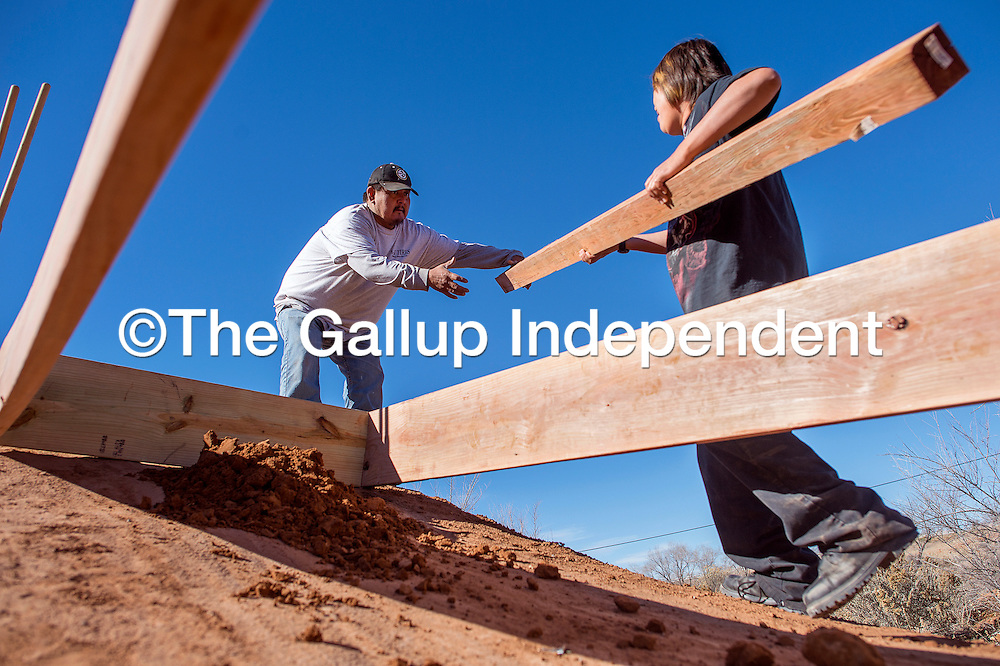 111213       Cable Hoover<br /> <br /> J.R. Plummer, left, and Lillian Vandever of Tohatchi Area of Opportunity and Services build a new wooden ramp at the Brickyard Bike Park in downtown Gallup Tuesday.