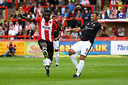 Troy Archibald-Henville (5) of Exeter City is put under pressure by Matt Rhead (9) of Lincoln City during the EFL Sky Bet League 2 match between Exeter City and Lincoln City at St James' Park, Exeter, England on 19 August 2017. Photo by Graham Hunt.