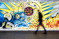 Colourful art on the East Side Gallery, Berlin, Germany
