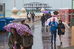 © Licensed to London News Pictures. 01/10/2016. Brighton, UK. Members of the public shelter from the rain under their umbrellas as Brighton and the South Coast are being hit by the occasional downpour. Photo credit: Hugo Michiels/LNP