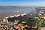 Nederland, Groningen, Delfzijl, 01-05-2013; haven Delfzijl met droogdokken en jachthaven Neptunus. Gezien naar Zeehavenkanaal (met strekdam), Eems in de achtergrond.<br /> Delfzijl harbor with docks and marina Neptune. In the background the Ems.<br /> luchtfoto (toeslag op standard tarieven);<br /> aerial photo (additional fee required);<br /> copyright foto/photo Siebe Swart