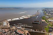 Nederland, Groningen, Delfzijl, 01-05-2013; haven Delfzijl met droogdokken en jachthaven Neptunus. Gezien naar Zeehavenkanaal (met strekdam), Eems in de achtergrond.<br /> Delfzijl harbor with docks and marina Neptune. In the background the Ems.<br /> luchtfoto (toeslag op standard tarieven);<br /> aerial photo (additional fee required);<br /> copyright foto/photo Siebe Swart