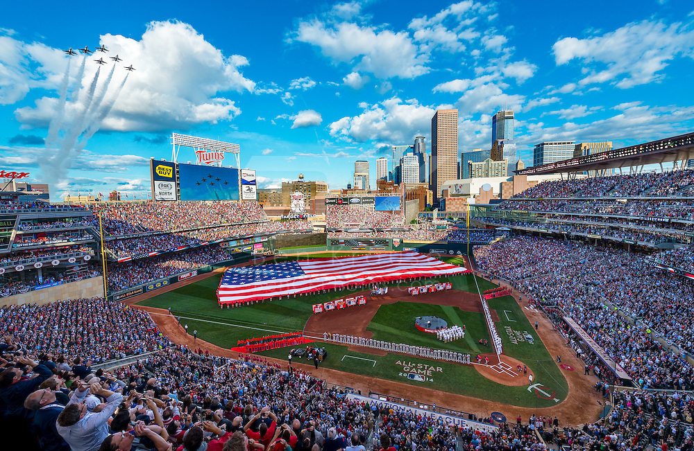 [Note:  This photo was created from multiple exposures and edited together during post-processing to capture the full range of light within the scene.]  Jets fly over Target Field during the national anthem performance before the start of the 2014 MLB All Star Game on July 15, 2014 in Minneapolis, Minnesota.  Photo by Ben Krause