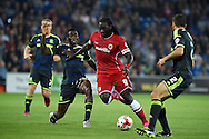 Kenwyne Jones of Cardiff city &copy;  holds off Middlesbrough's Kenneth Omeruo (l) .Skybet football league championship match, Cardiff city v Middlesbrough at the Cardiff city stadium in Cardiff, South Wales on Tuesday 16th Sept 2014<br /> pic by Andrew Orchard, Andrew Orchard sports photography.