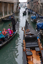 A view of various gondoliers on a canal in Venice. From a series of travel photos in Italy. Photo date: Sunday, February 10, 2019. Photo credit should read: Richard Gray/EMPICS Entertainment